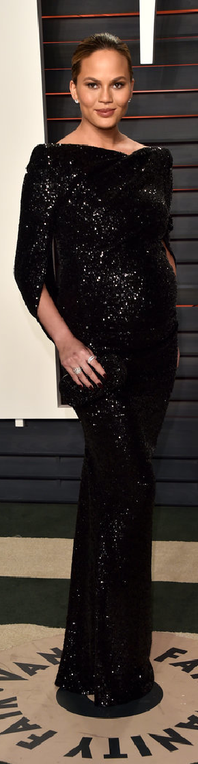 Chrissy Teigen Wearing a sparkly Talbot Runhof black gown at Vanity Fair's Oscar party.