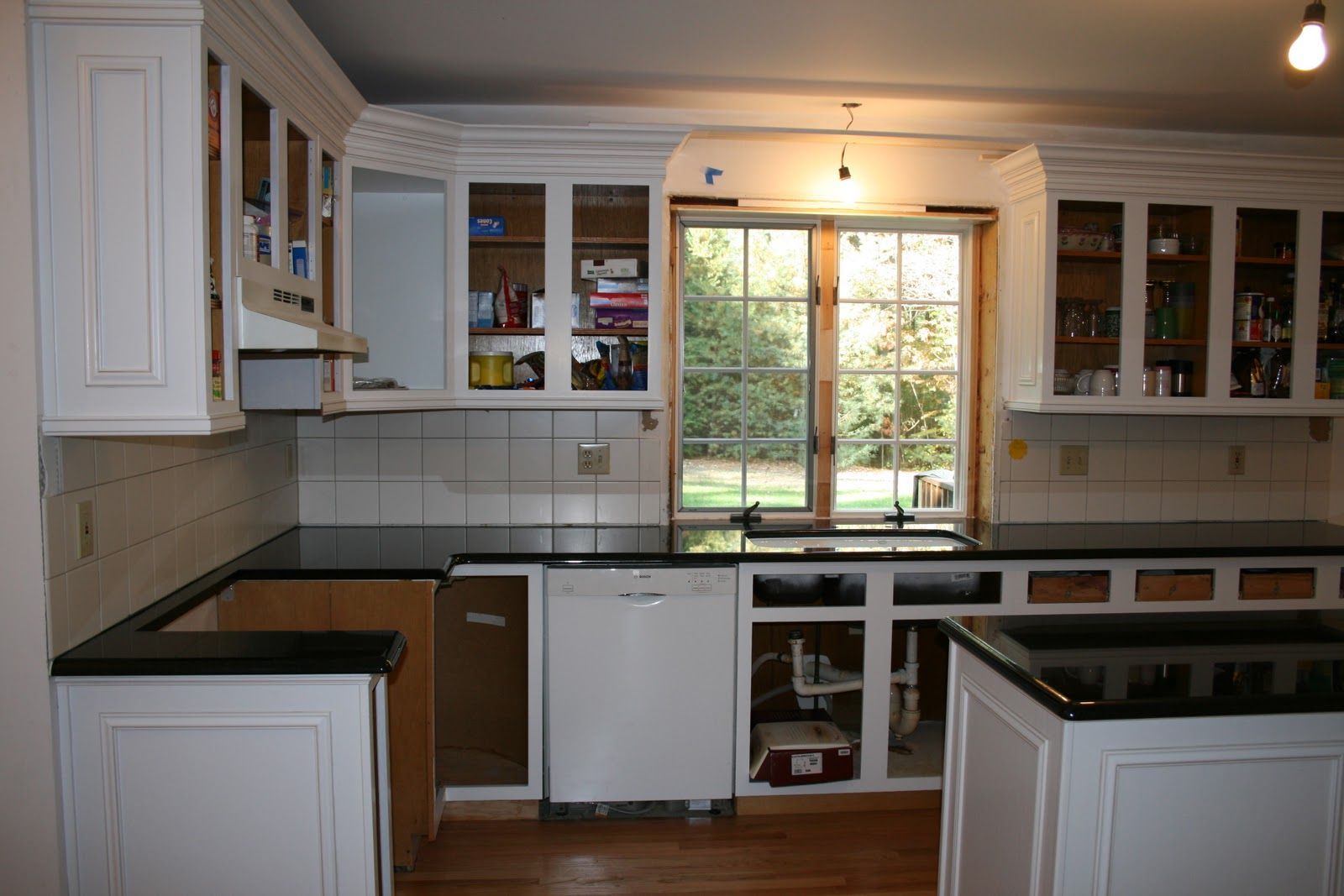 Add decorative molding to dated oak stock cabinets for an ...