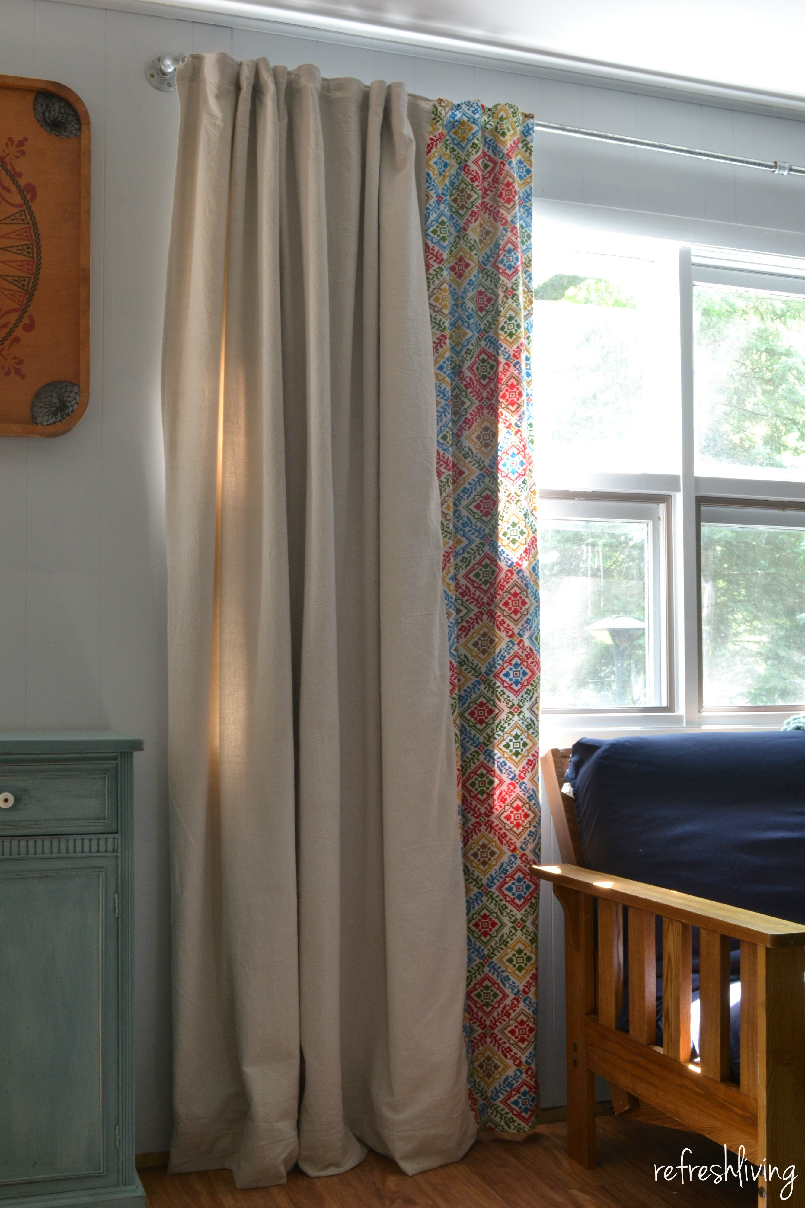 Cheap window coverings  diy drop cloth curtains modified for a large window  drop cloth