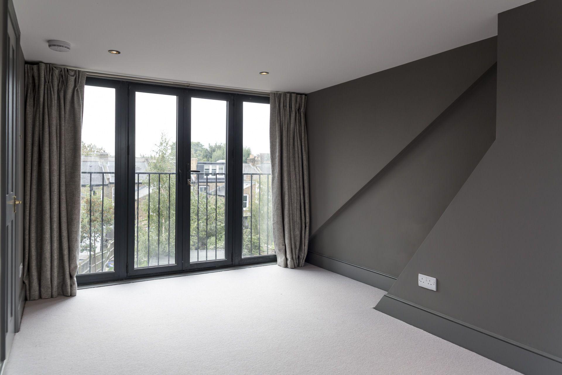 A Fantastic Rear Dormer Loft Conversion With Grey Walls For A Dramatic Modern Look Dormer Loft Conversion Loft Conversion Windows Loft Conversion