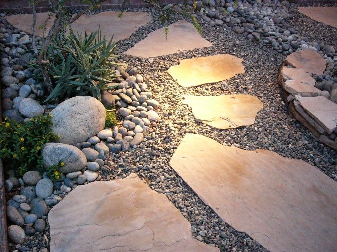 Flagstone path xeriscape flagstone path garden for Installing river rock landscaping