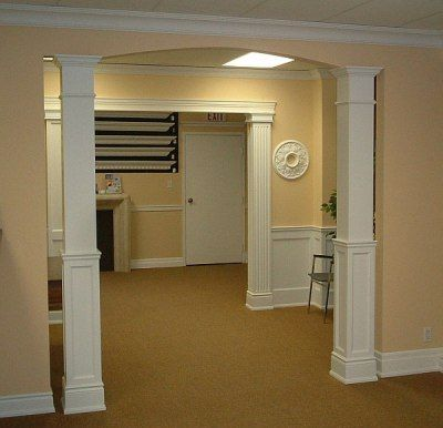 I like the look of the faux pillars both shown here for Columns in houses interior