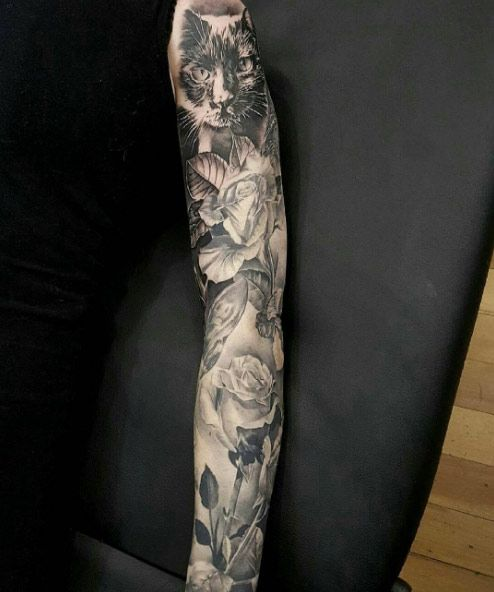 Stunning hyper-realistic floral sleeve by Mrs Campbell