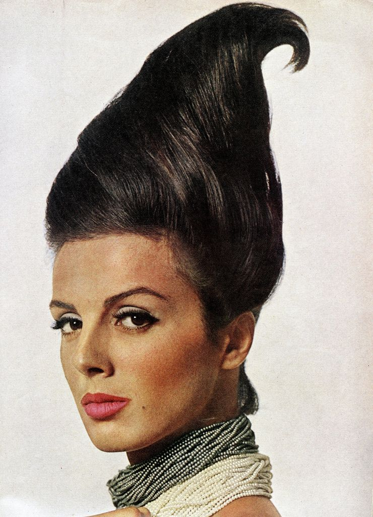"""Sporting the strangest hair I have ever seen. Beautiful Tilly for Charles of the Ritz make-up collection called """"Cultured Pearl"""", coiffure by Mr. Thornton also of Charles of the Ritz, faux seed pearls by Trifari, photo by Bert Stern, Vogue US, March 1963"""