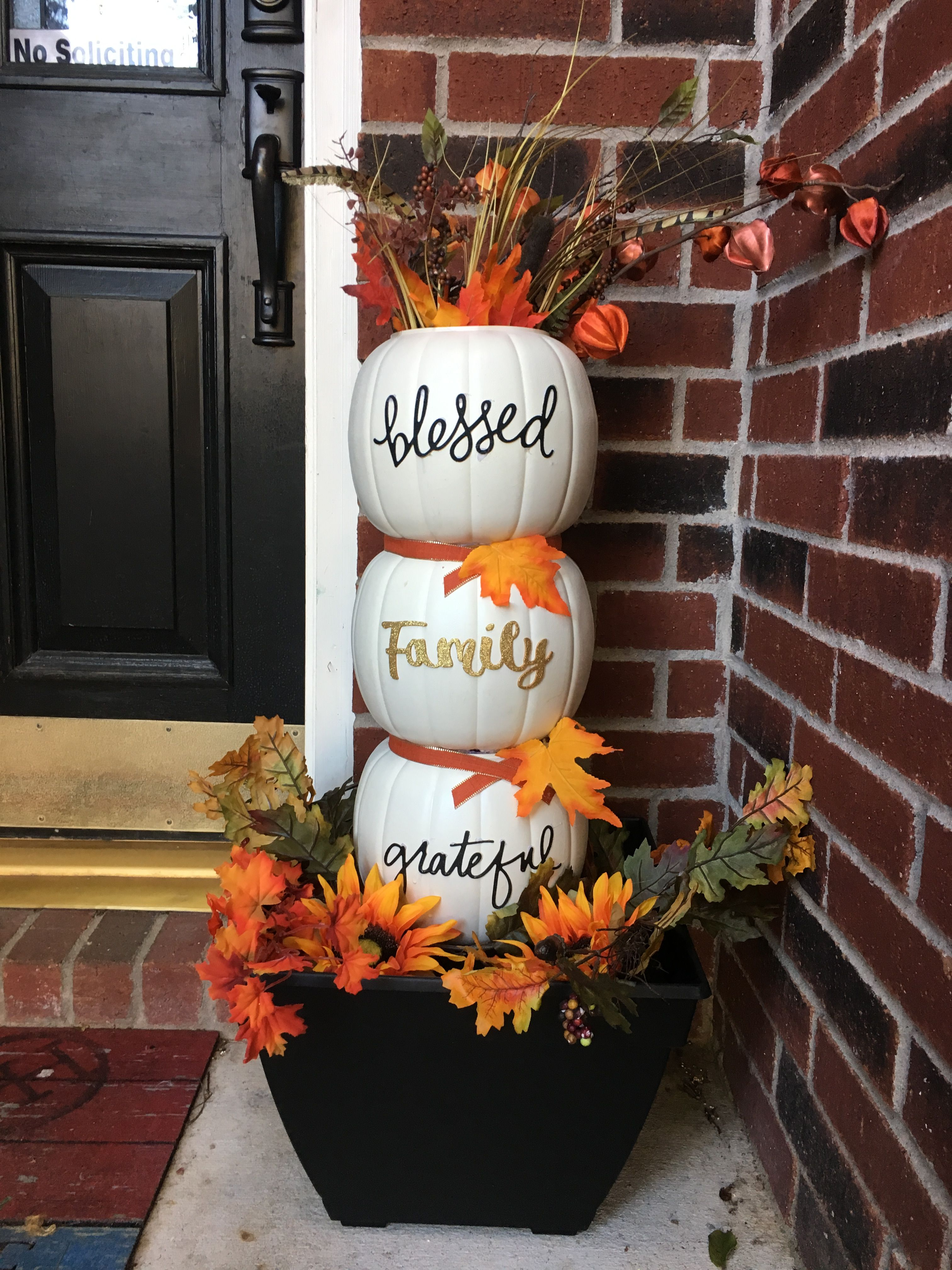 Used the plastic pumpkins and painted them off white. Might have been better to use vinyl letters without bling so you can easily spray sealant. #fallfrontporchdecor