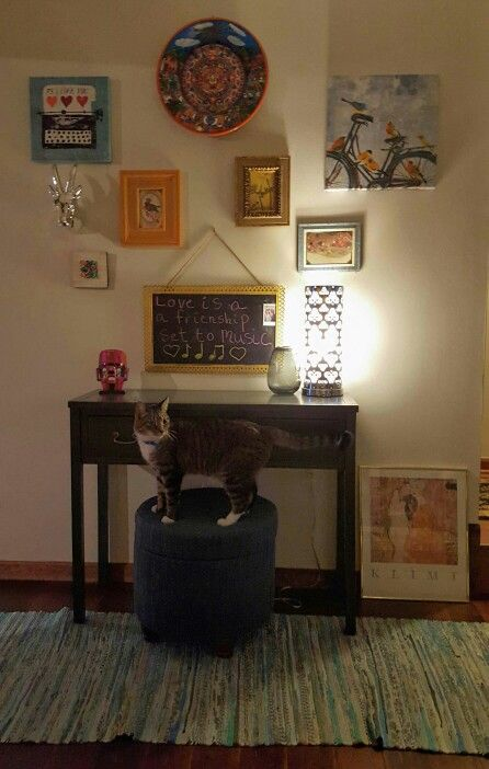 My console table with my own take on a super eclectic wall collage ...