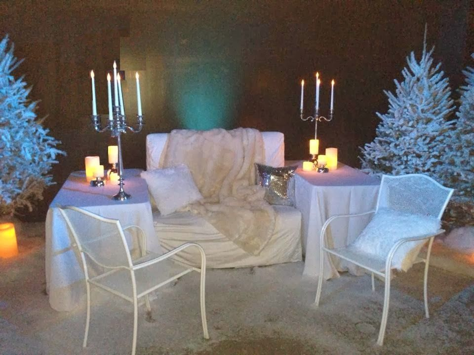 """Lounge furniture and decor elements from Dallas Light and Sound looking """"cool"""" in the basement of the Davis Building in a collaborative design for the Teddy Bear Party. Design legend Mark Clay supplied fabulous fur throws to keep guests warm in this chilly winter wonderland."""