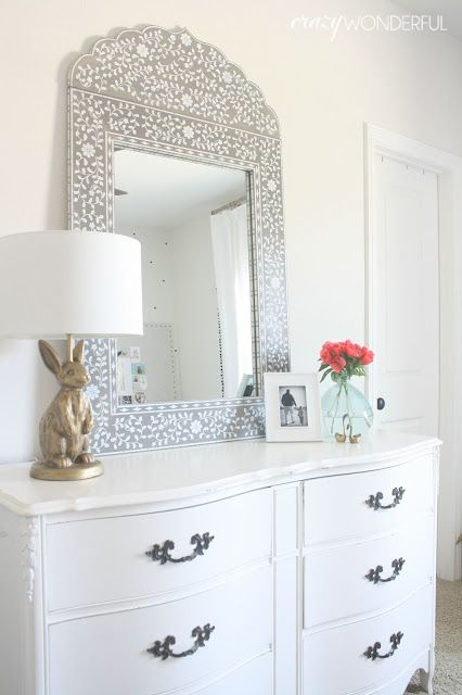 DIY inlaid mirror- awesome moroccan inspired mirror made from scratch!  She cut the wood and painted it to give it this look.