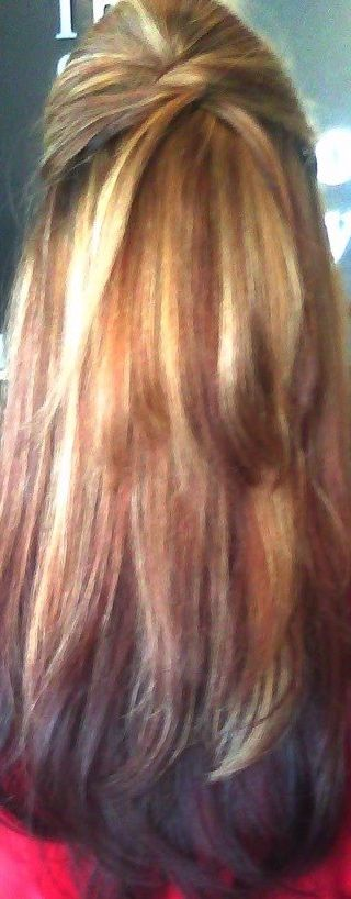 Color cut and style I did a while ago. Deep reds soft blonde highlights and long layers