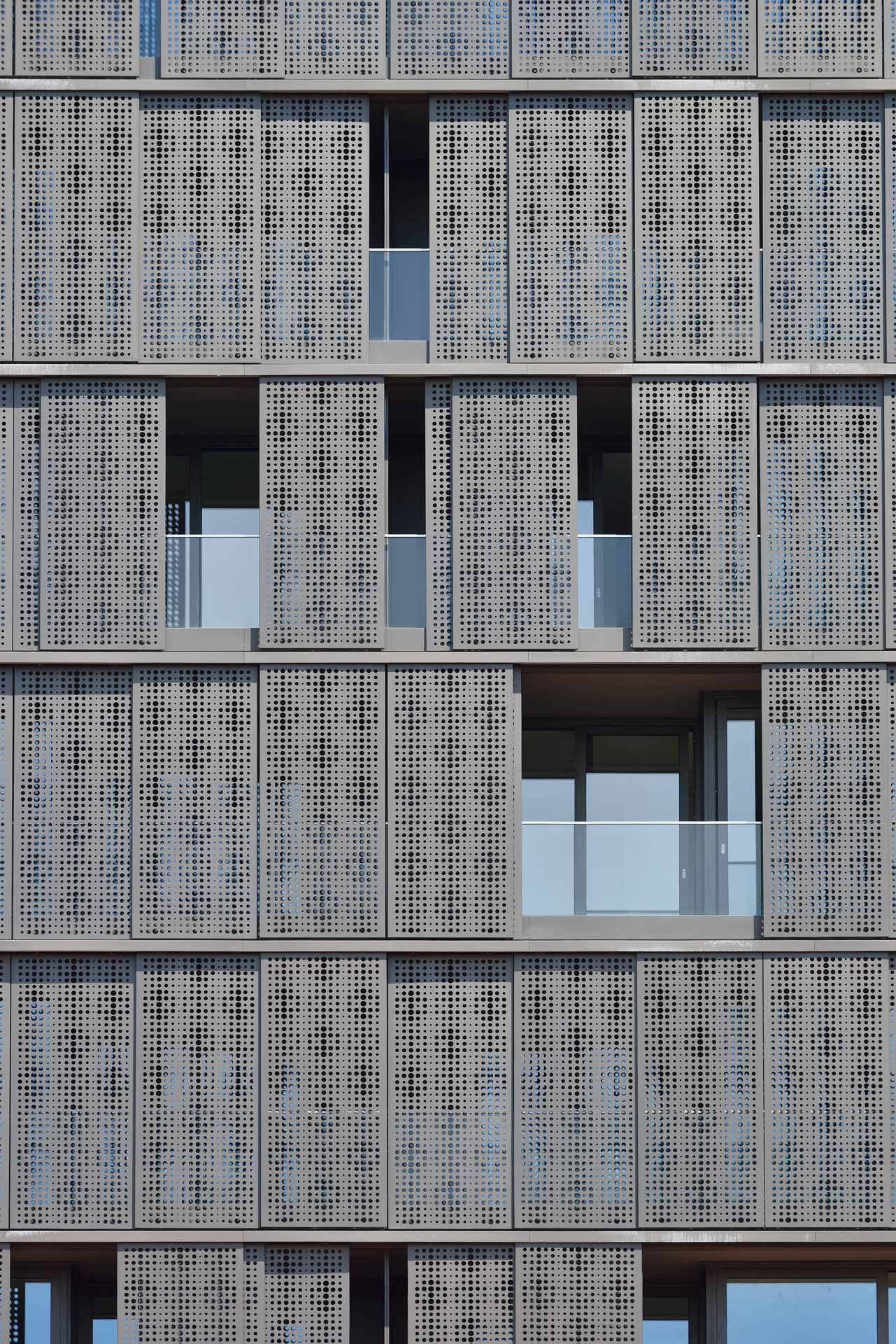 The sliding perforated aluminium panels cladding the for Window design normal