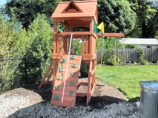 Small Backyard Playsets Into A Space Saver For Small Yards