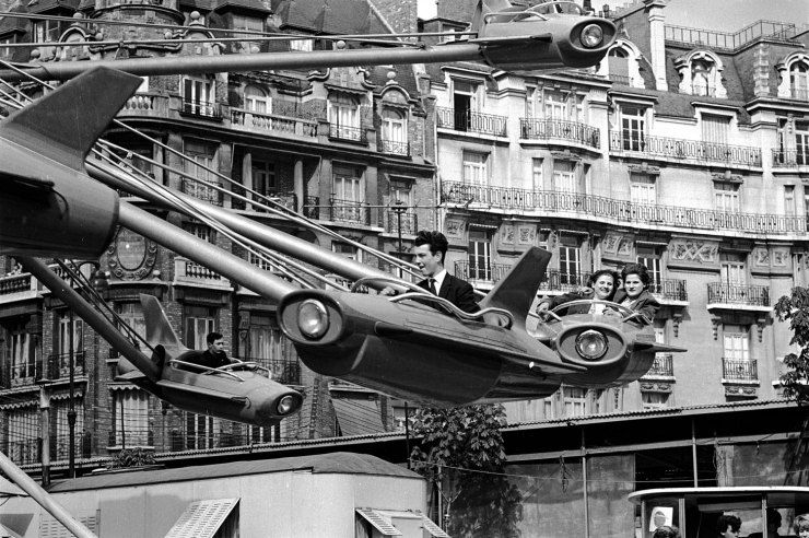 Parisians enjoying an amusement park ride, 1963, Alfred Eisenstaedt.