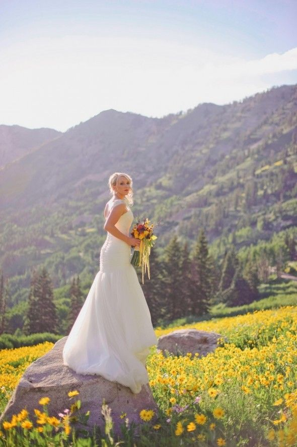 Rustic Chic Wedding: love the bride standing on a rock (or tree stump) with the view in the background.