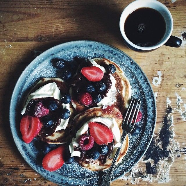 """Today's breakfast. Pancakes with whipped cream, homemade nutella and berries """