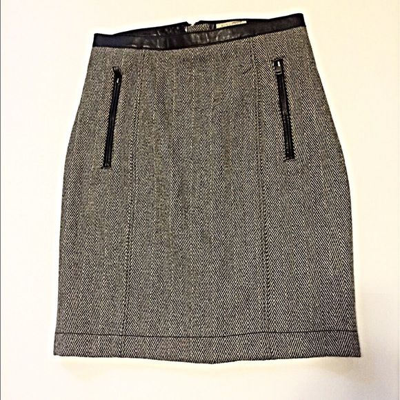 "Burberry Brit Wool Herringbone Skirt w/ Leather Black and cream herringbone pattern in a heavy lined wool blend fabric. Leather trim on waist band, zippered pockets and back zipper. Small kick pleat in back. Zipper pulls are embossed with Burberry logo. A classic skirt that belongs in every working woman's closet. NWT from Nordstrom. Runs small - waist 15"" lying flat. Length is 21"". Burberry Skirts Pencil"