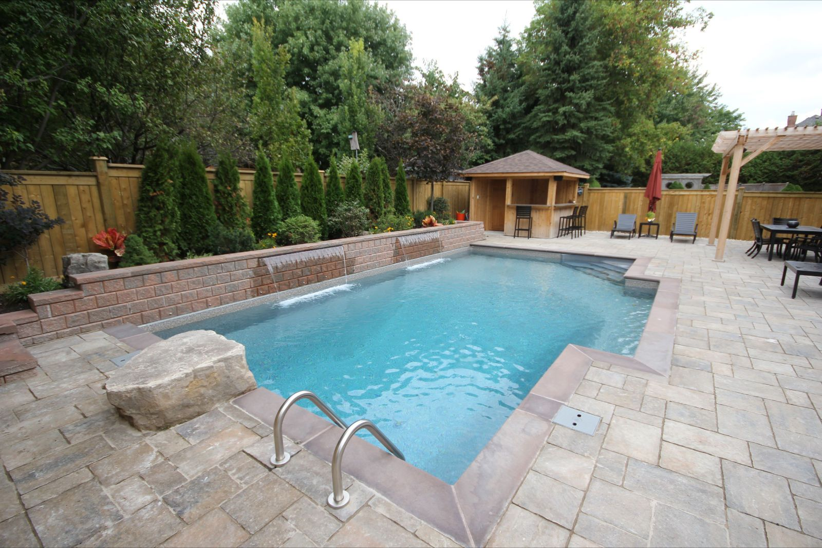 Custom rectangle inground pool with spill over spa pools for Custom inground swimming pools