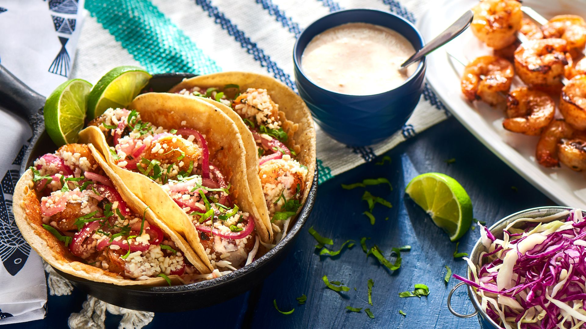 Capture the taste of summer time with Tequila Grilled Shrimp Tacos Flame grilled shrimp are enhanced with chipotle tequila cream sauce, the tangy crunch of pickled onions, and delicious Sierra® Cotija cheese. #LoveMyQueso