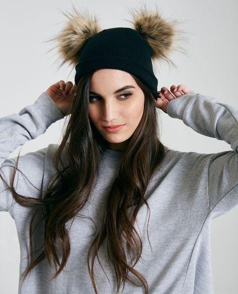 """<p>This beanie features a soft knit body to keep you warm in the fall, a double pom detail, and a comfy, oversized fit.</p>  <ul> <li>18.5"""" Circumference</li> <li>Acrylic</li> <li>Hand Wash</li> <li>Imported</li> </ul>"""