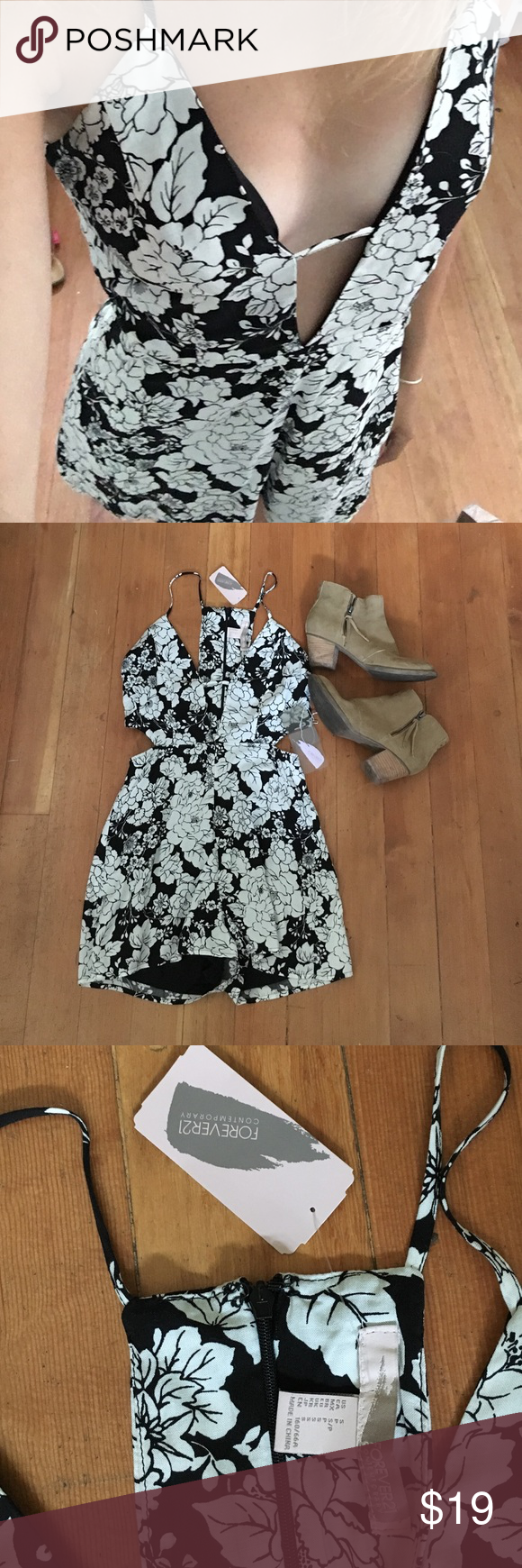 Forever 21 floral romper  NWT black and white floral romper from Forever 21! Front forms a deep V with cut outs on the waistline. Very summery and pretty design Forever 21 Dresses
