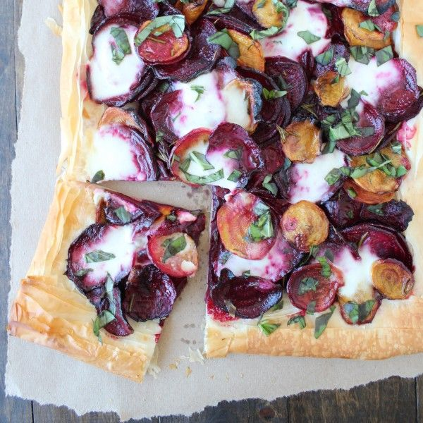 This vegetarian beet and burrata cheese tart combines layers of roasted gold and purple beets with creamy burrata on a phyllo dough crust.