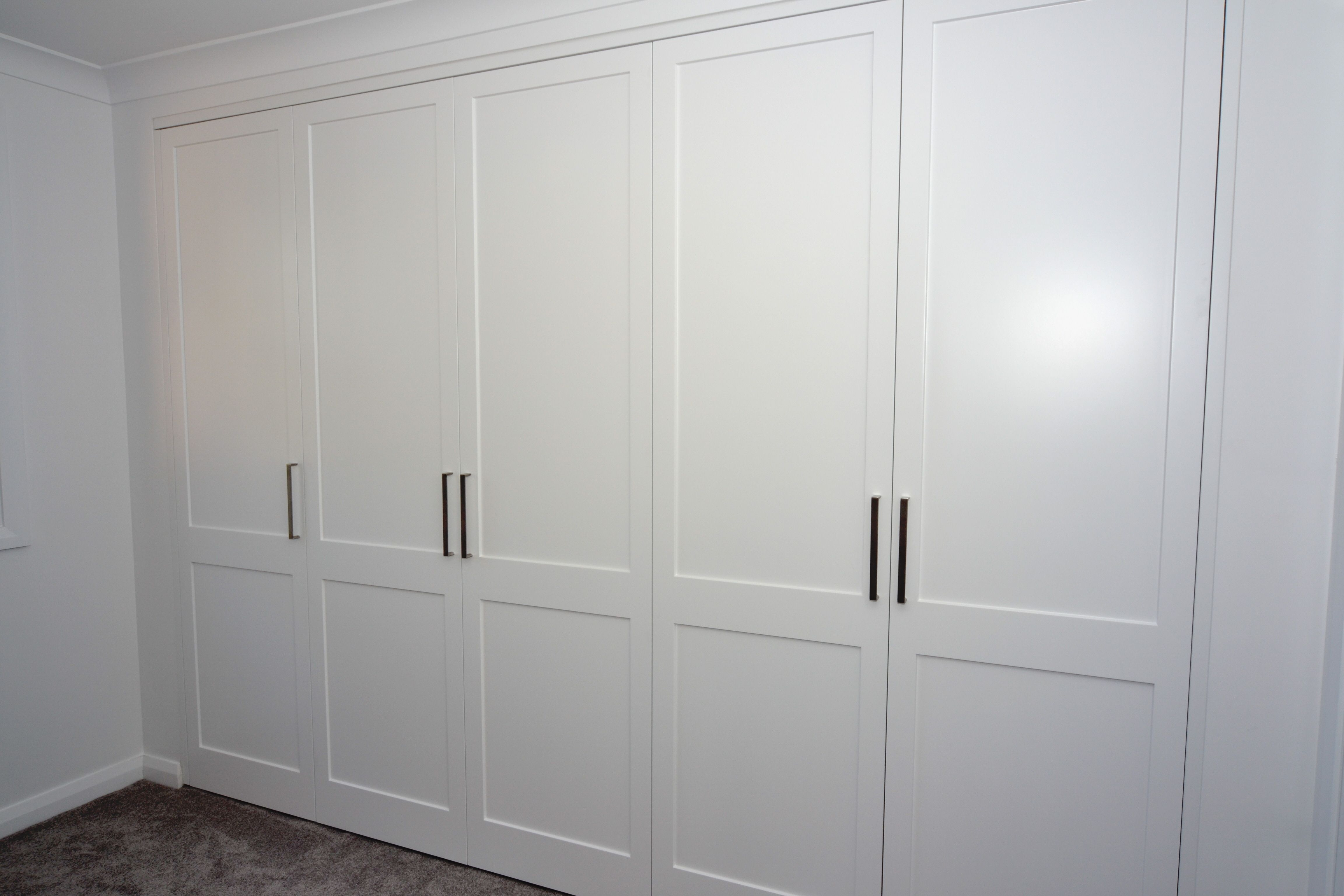 Luxurious White Solid Hardwood Built In Wardrobe With Simple Models As Inspiring Modern Closet Cabinet Designs