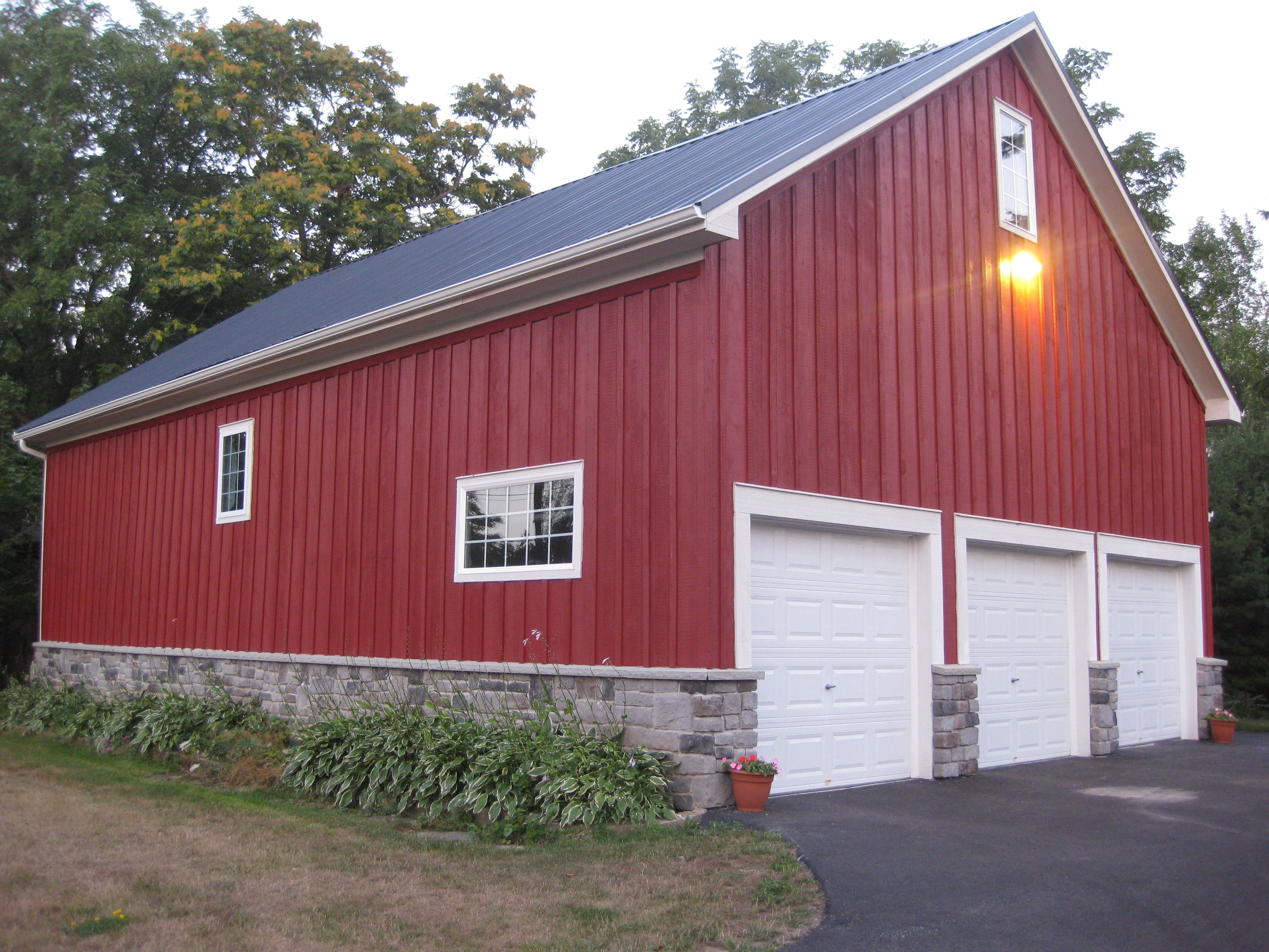 Barn garage refinished with board and batten metal roof for Metal board and batten siding