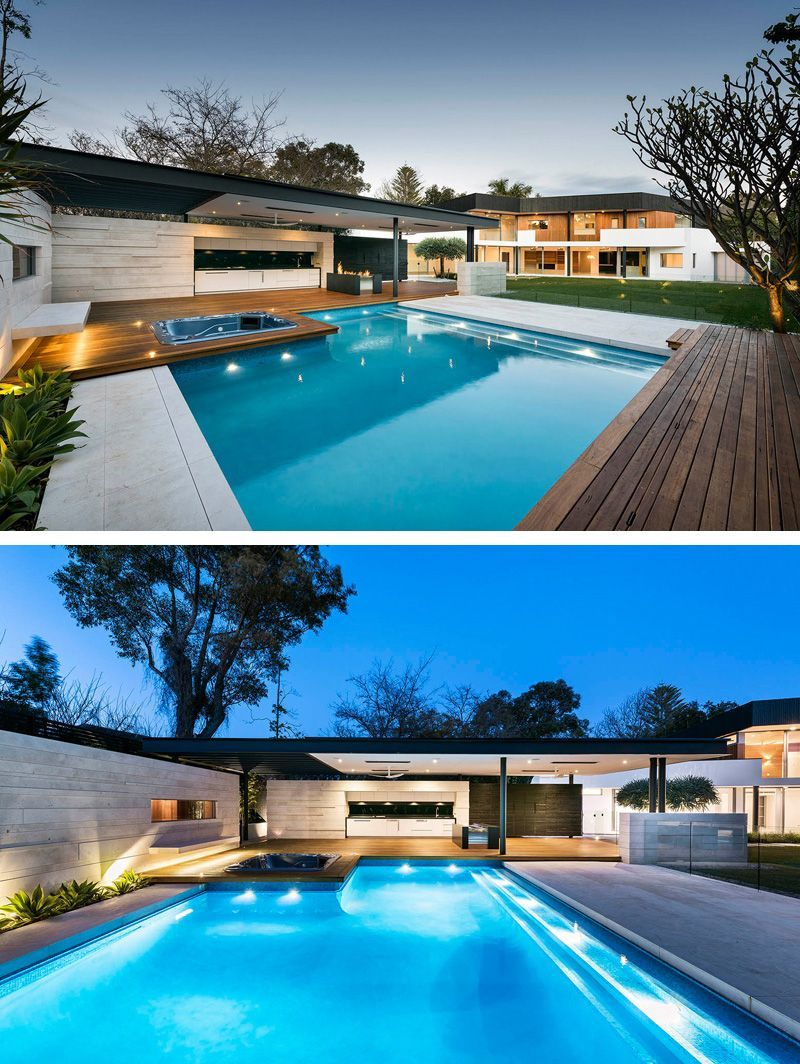 The Outdoor Space Features An Expansive Grassy Area, With