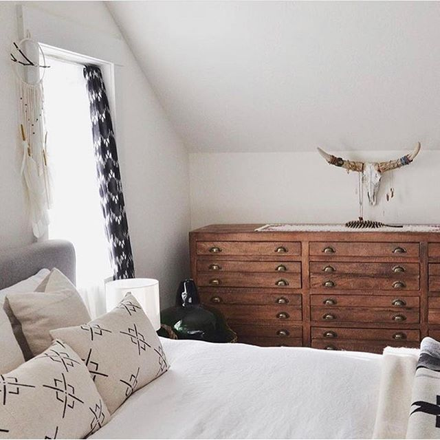 small space bedroom inspiration. vintage dresser and boho textiles. love the cow skull for necklace storage.