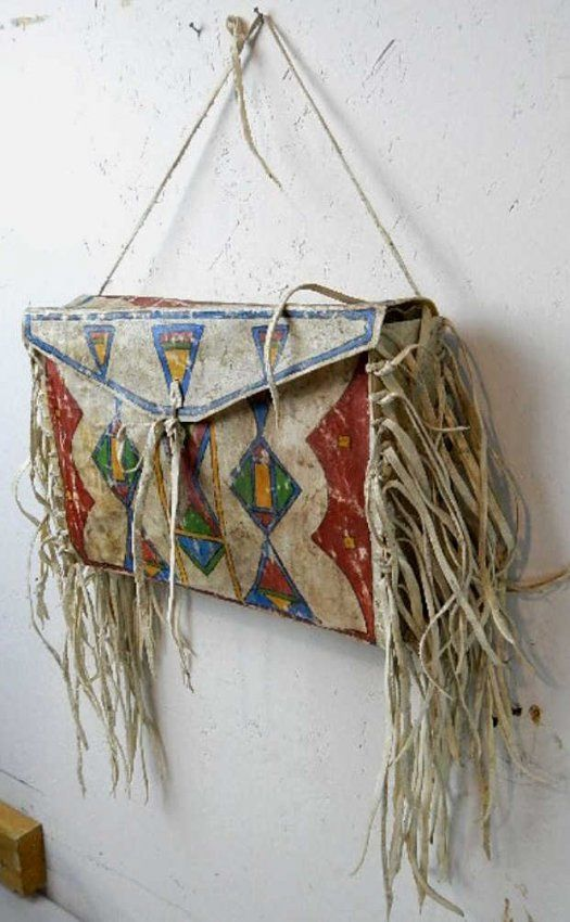 """This bag is a parfleche and was used by the Sioux Native Americans typically for holding dried meats and pemmican. This word originated from the French and stands for the toughness of the Rawhide as it was strong enough to be used as a shield. All hand painted and in excellent condition. This bag measures 10"""" high x 14"""" long."""