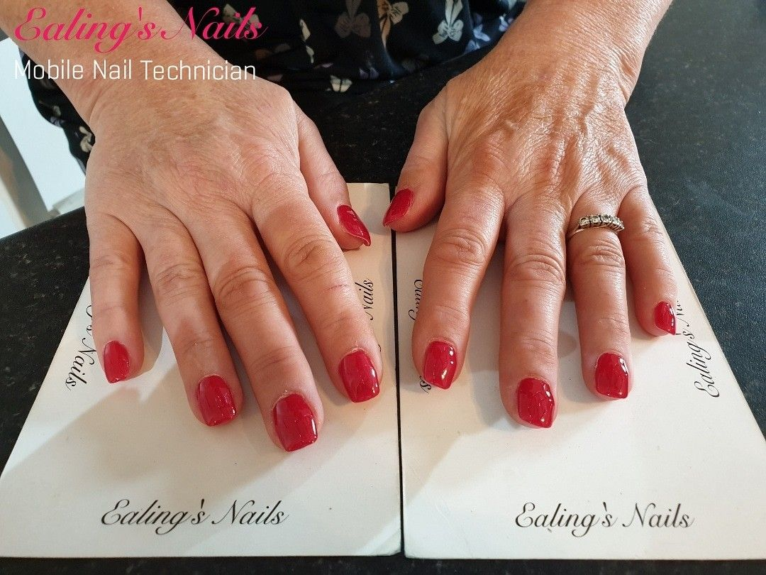 Kiara Sky dip powder extensions with Naio Nails Purely Red