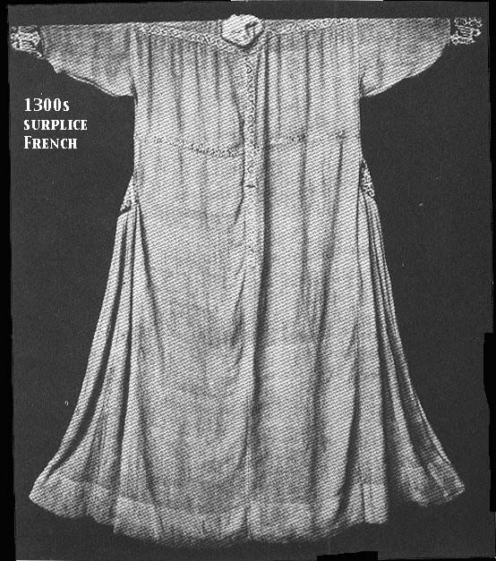 """1300s surplice, French. National Museum, Munich.  Note band of trim across chest, shoulders, and vertical in center. Godets at side reinforced (?) with embroidered patches that match cuffs.   From Kohler, who notes that it is of """"white linen, braided with blue and red.""""    additional info from Nancy Stengel"""