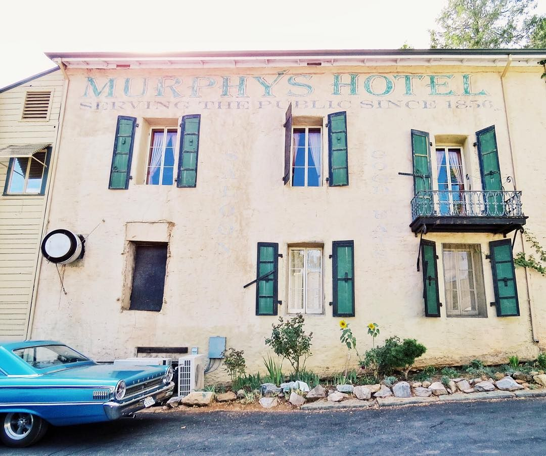 Murphys Historic Hotel in California's fascinating old gold-mining country has saloon downstairs and a gorgeous, shaded patio area. (Plus, Murphys is the CA wine country you never heard of.)
