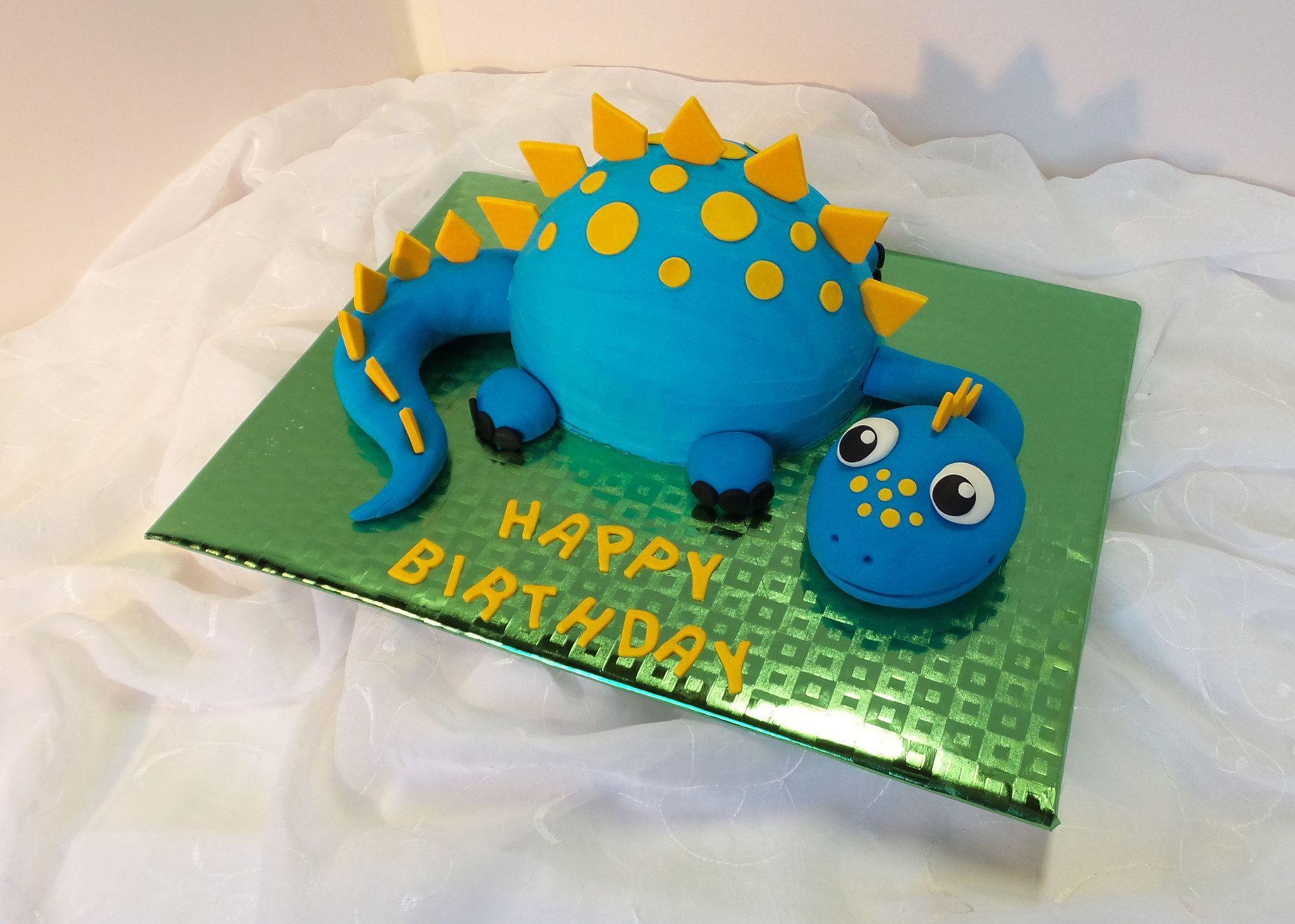 Blue Dinosaur Shaped Birthday Cake