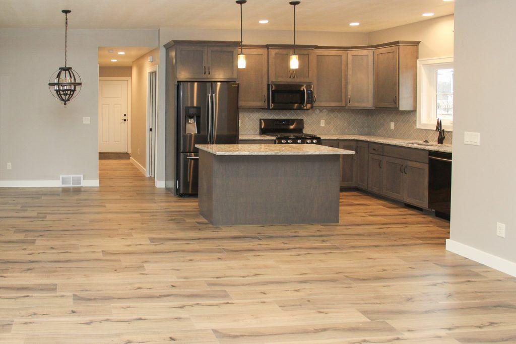 Light Wood Looking Laminate Kitchen Floor Laminate Flooring In Kitchen Laminate Kitchen Kitchen Flooring