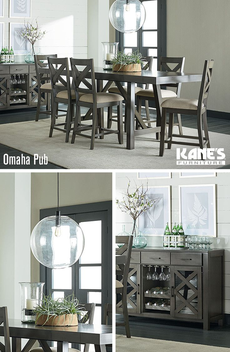 Create polished perfection in your dining room with the Omaha Pub dining set! The stylish gray finish is an unusual take on the otherwise classic silhouette of the table and cross back chairs. The matching wine cabinet doubles as a glass storage space for easy access during dinner.