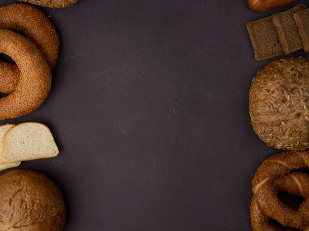 Download Top View Of Breads As Bagel Classic And Seeded Cob Bagel White And Rye Bread Slices On Maroon Background With Copy Space for free