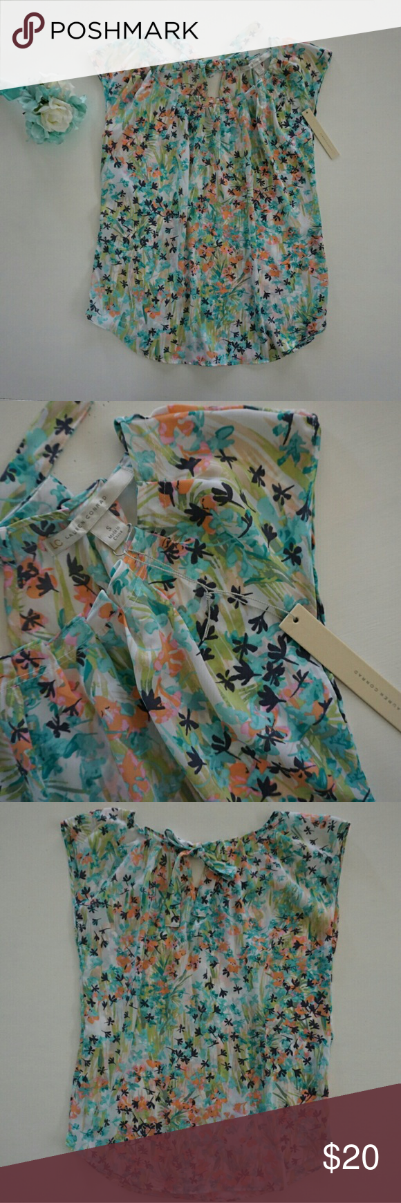 """LAUREN CONRAD PLEAT NECK FLORAL SHEER TOP Lauren Conrad pleat neck, sheer, short sleeved top with floral print and tie at back of neckine. Print is peach, pink, green, teal, aqua, eggplant purple, and white.  Size Small  Armpit to armpit 19"""" across laying flat  Shoulder to hem  26"""" New with tags Lauren Conrad  Tops Blouses"""