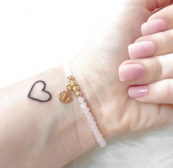 Photo of small heart tattoo                                                              …