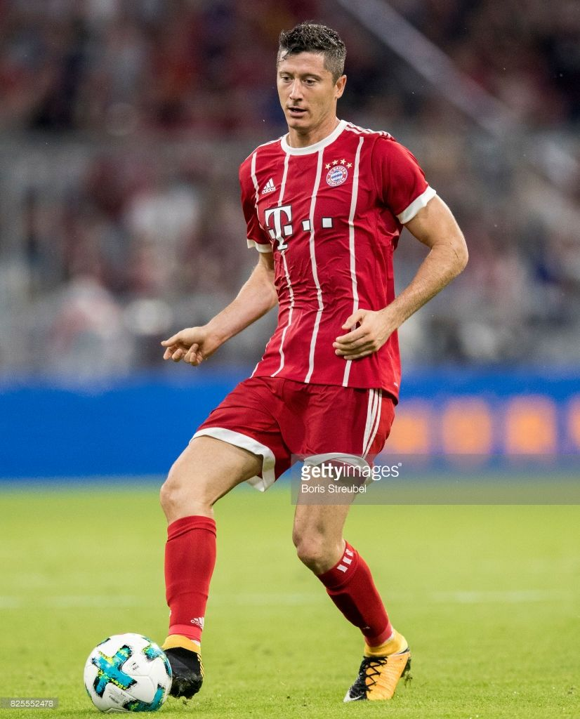 Robert Lewandowski of FC Bayern Muenchen runs with the ball during