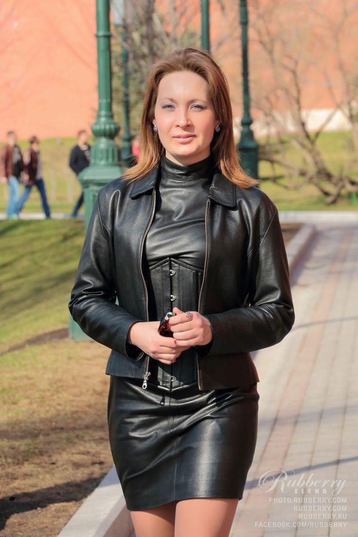 Mature amateur Elena wearing black leather minidress corset and leather  jacket in public