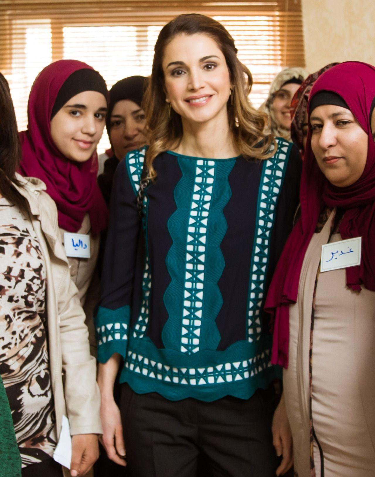 23 January 2017 - Queen Rania visits Hashimayat Al Zarqa District - blouse by Tory Burch, earrings by Ileana Makri