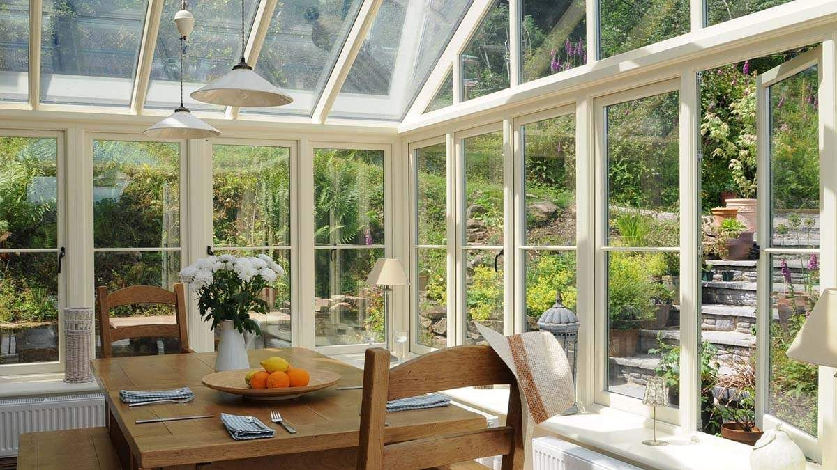 Gable end window ideas  conservatory inside with table and hat  build  pinterest  bespoke
