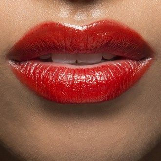 Red glossy lips.