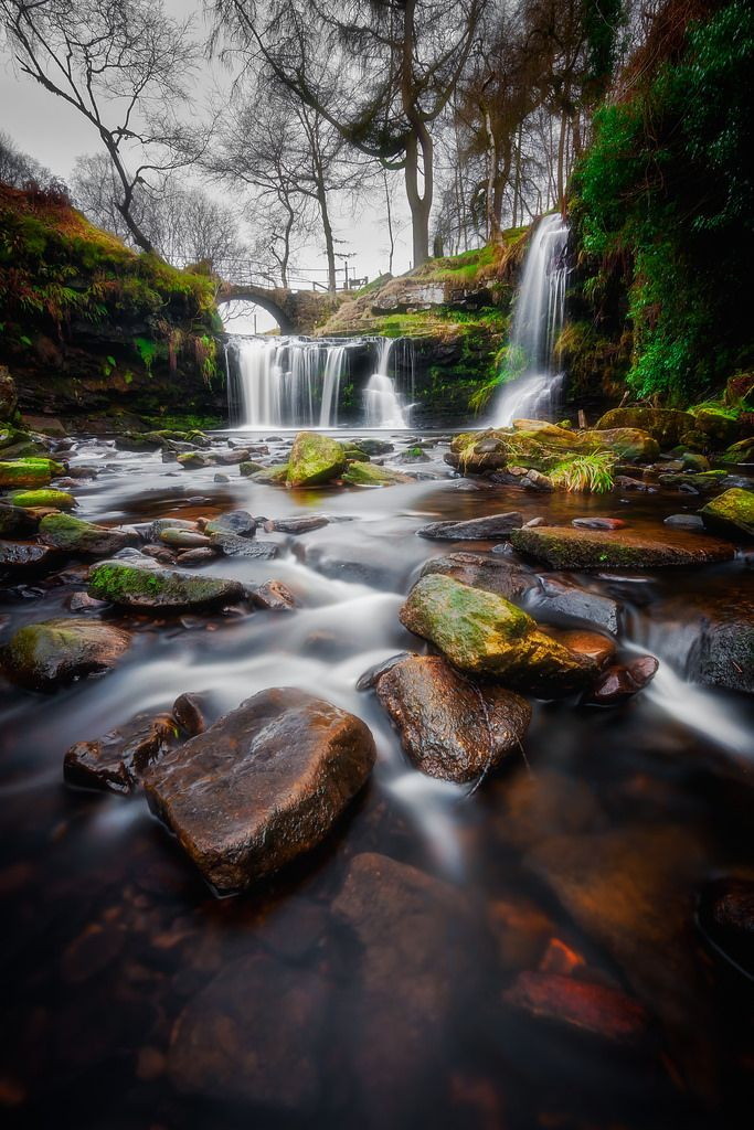 "Mariusz Talarek posted a photo:  Lumb Hole Falls, Hebden Bridge, West Yorkshire, UK.  Yesterday was monochrome. Today is time for colour.  --------------------------------------------------------  As yesterday's monochromatic photograph was made of single exposure, this one was a little bit more time consuming...  11mm | f/9 | ISO 250 | exposure time below  DRI (Digital Range Increase) image blended in Photoshop from 4 exposures as follows:  1 - 5'20"" with exposure compensation set to +1EV…"