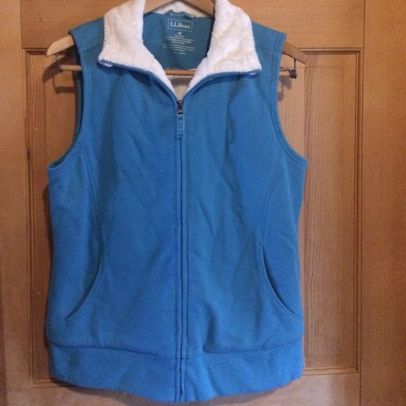 L.L.Bean best medium turquoise EUC llbean vest. Sweatshirt material with super soft furry lining! Turquoise color with creamy white lining.  Great layer on a cold day. The color just isn't working for me - this is in need of a new loving home! L.L. Bean Jackets & Coats Vests