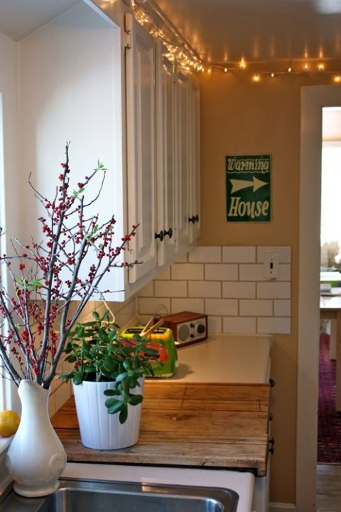 15 Genius Solutions for the Awkward Space Above Kitchen ...