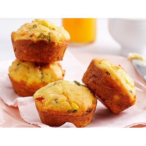 Corn and polenta muffins recipe - By Woman's Day, These light and fluffy savoury muffins are perfect for a work or school lunch box. Packed full of juicy corn, fluffy polenta and delicious sun-dried tomatoes, these are a great vegetarian on-the-go treat that will keep you fueled for hours.