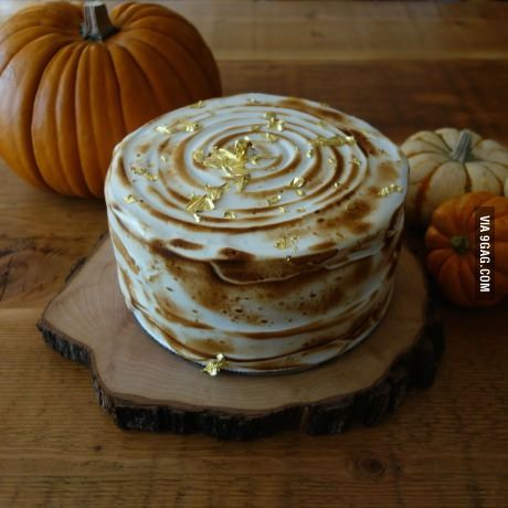 Lemon Meringue Cake with gold leaf accents
