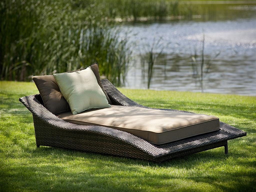 large grey rattan wicker outdoor patio chaise lounge with brown