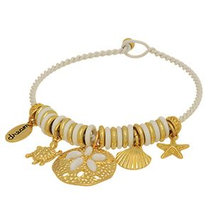 """White charm bracelet featuring a twisted bangle with gold tone sea life charms and a charm stamped """"dream""""."""